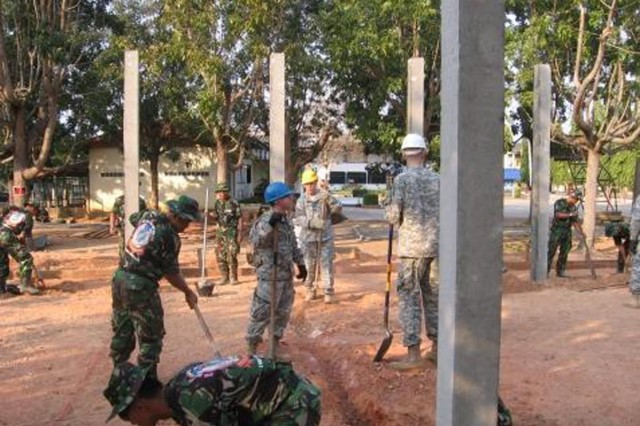 56th Engineer Company Soldiers and their Indonesian and Thai partners begin construction of a multipurpose masonry building for a Thai school.