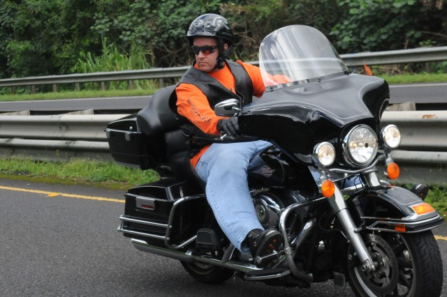 Maj. Adam Scherer, deputy of logistics, 94th Army Air and Missile Defense Command, prepares to change lanes during a group safety ride from Fort Shafter, Hawaii, to the Nuuanu Pali lookout, Jan. 21. The purpose of the event was to promote safety, familiarize with road conditions and build camaraderie among mortorcylcists of the 94th AAMDC.
