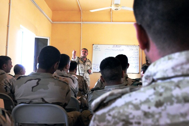 BAGHDAD - An Iraqi Armor School instructor, communications wing, teaches proper tactical radio communications to Basic Communications Course students at Camp Taji's Iraqi Armor School in late October. Practical instruction includes operations of the American Single Channel Ground and Airborne Radio System, as well as the Russian 123 and Chinese 889 radios.