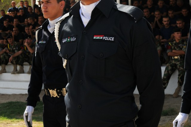 BAGHDAD - Honor graduate, Muner Lafta Ali, a member of the first class of police commissioners to graduate from the Police Commissioner Institute conducts a marching drill during the graduation ceremony at the Baghdad Police College Parade Field in late October.