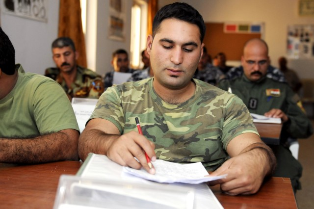 Iraqi Police Improvised Explosive Device technician Ali Ghalib Ghulam takes notes during a General Counter Explosive Directorate EOD Equip and Train Development Course lecture, taught at the Federal Police Training Center in Baghdad, in late October.