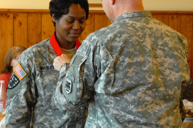 Chief Warrant Officer 4 Marilynn Bradley receives the Samuel Sharpe Award at a ceremony in Longare, Italy, Jan. 21.