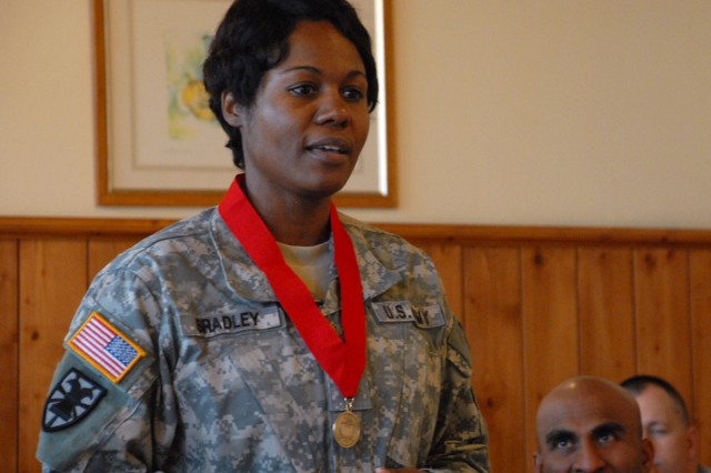 Chief Warrant Officer 4 Marilynn Bradley makes remarks upon receiving the Samuel Sharpe Award at a ceremony in Longare, Italy, Jan. 21.