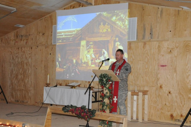 U.S. Army Chaplain (Maj.) Randal H. Robison of Grand Prairie, Texas, brigade chaplain for 4th Brigade Combat Team, 101st Airborne Division, recites the story of the Nativity scene and the night of Jesus Christ's birth during a Protestant service at the Frontline Chapel at Forward Operating Base Sharana Dec. 24.