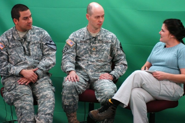 FORT POLK, La. - Chaplain (Maj.) Donald Ehrke (center), brigade chaplain, and Staff Sgt. Timothy Muckle (left), a chaplain's assistant with the 2nd Brigade Combat Team, 1st Cavalry Division, conduct an on-camera interview with a role-playing reporter during public affairs training at the Joint Readiness Training Center, Fort Polk Jan. 13.
