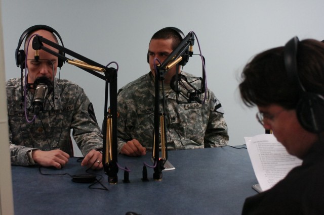 FORT POLK, La. - Chaplain (Maj.)  Donald Ehrke (left), brigade chaplain, and Staff Sgt. Timothy Muckle (center), a chaplain's assistant with the 2nd Brigade Combat Team, 1st Cavalry Division, conduct a radio interview with a role-playing reporter during public affairs training at the Joint Readiness Training Center, Fort Polk Jan. 13.