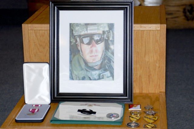 FORT HOOD, Texas - The memorial photo of Staff Sgt Justin K. Tate, formerly with 1st Battalion, 12th Cavalry Regiment, 3rd Brigade Combat Team, 1st Cavalry Division Jan. 21.