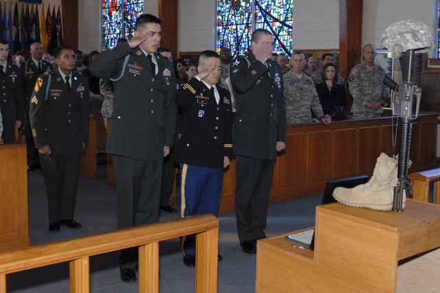 FORT HOOD, Texas - Soldiers salute the memorial display of Staff Sgt Justin Tate, of 1st Battalion, 12th Cavalry Regiment, 3rd Brigade Combat Team, 1st Cavalry Division, Jan. 21 at a memorial service held in his honor.