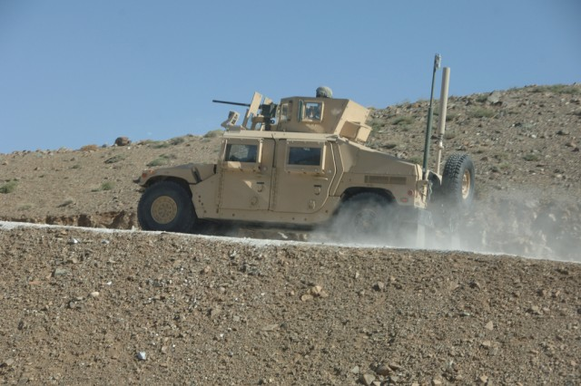 Soldiers patrol through rugged terrain in a humvee in the mountains of Tagab Valley, Kapisa Province, Afghanistan, April 1, 2008.