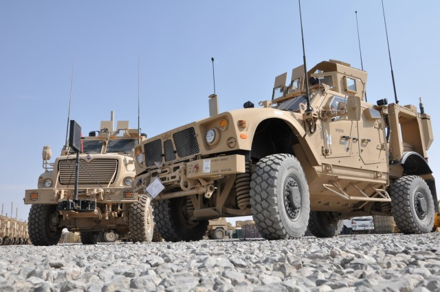 A new Mine-Resistant, Ambush-Protected All-Terrain Vehicle, built specifically for the mountainous Afghan terrain, parks next to a larger MRAP, MaxxPro Dash. The first M-ATVs designated for Southern Afghanistan arrived at Kandahar Airfield, Afghanistan, by air transport, Oct. 22, 2009.