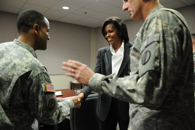First Lady Michelle Obama greets Col. Joseph Coleman during her visit to Fort Jackson, S.C., Thursday.