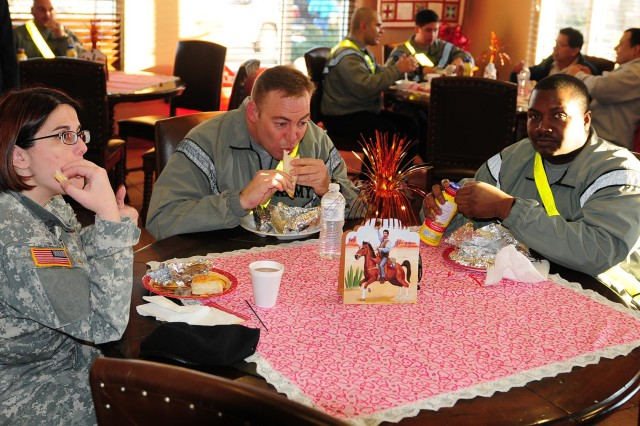 FORT SAM HOUSTON, Texas - Soldiers sit back and enjoy a breakfast taco treat during the Warrior and Family Support Center's 2nd Annual Cowboy Breakfast Jan. 27 at the WFSC. The Cowboy Breakfast, with the support of its sponsors, donated 3,000 breakfast tacos for the event as a way to say thank you for the sacrifices of the Soldiers, their Family members and the caregivers.
