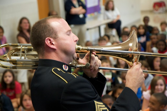Staff Sgt. Wesley Ballenger, trombonist, performs for students in Howard County, Md. as part of the Field Band's musical education outreach program. In 2011 the Army Field Band will be performing numerous masterclasses, clinics and recitals with students throughout the country.