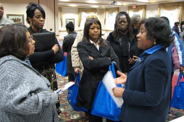 JoAnn Pittman (right), a public affairs specialist with the Food and Drug Administration (FDA), talks with individuals about the role of the FDA in making food and drugs safe for consumption through -out the nation. Pittman stressed that  workers for the FDA touch everyone's lives every day, leading to a good work environment. Pittman said the  FDA is currently interested in people with science backgrounds.