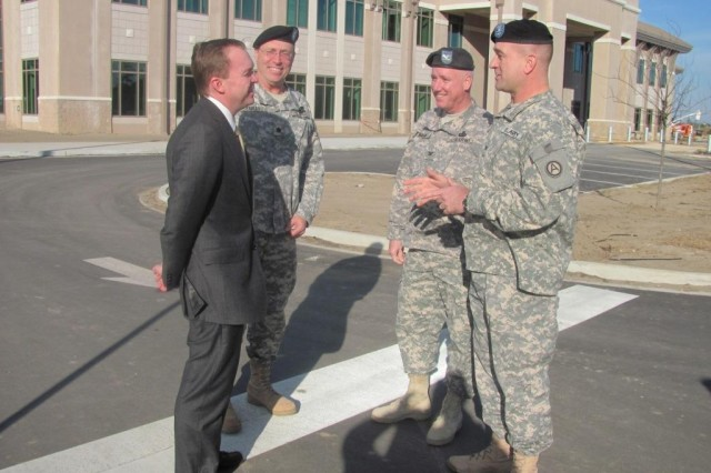 """SHAW AIR FORCE BASE, S.C. (Jan. 28, 2011) - (From left) The Honorable John M. """"Mick"""" Mulvaney, U.S. Congressman for South Carolina's Fifth district, Lt. Col. Mal Earles, Third Army/U.S. Army Central Deputy Chief of Staff for Strategic Relocation, Col. Jerry O'Hara, Third Army/USARCENT Public Affairs Chief, and Col. Tracy Banister, Third Army/USARCENT Fires and Effects Chief, stand in front of Third Army's new headquarters building currently under construction at Shaw Air Force Base, S.C., Jan. 28. After meeting with leadership and touring the base, Mulvaney commented on the command's move to the Sumter community.  """" I don't think it's possible to overemphasize the importance of this last development to Shaw AFB which is the addition of Third Army."""""""