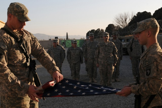 Spc. Nathan Smith, a native of Anchorage, Alaska, and Spc. Barrett McClung, a native of Phoenix, Ariz., from the 404th Civil Affairs Battalion, Airborne, fold the World Trade Center flag on Jan. 24 at Forward Operating Base Salerno in Khowst Province, Afghanistan. The flag is carried by the 404th Civil Affairs Battalion, Airborne to different FOBs in Regional Command - East, Afghanistan to give Soldiers a chance to see the flag. The 404th will carry the flag for a year, and then returned to Ground Zero in July of 2011 to be put on display in the Ground Zero Museum. (U.S. Army photo by Spc. Tobey White, Task Force Duke)
