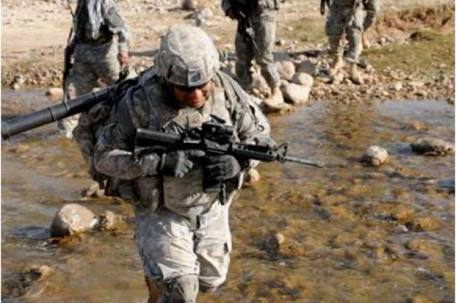 Soldiers of Company C, 1st Battalion, 4th Infantry Regiment, cross a stream during a foot patrol in the Cheniahs of Afghanistan's Zabul province.  The 1-4 recently completed a nearly decade-long mission in Afghanistan in cooperation with the Romanian Land Forces.  The 1-4 had been the longest continously serving U.S. Army unit in Afghanistan.