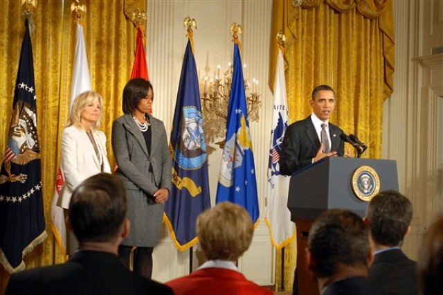 President Barack Obama announces a whole-of-government initiative to benefit military families as Jill Biden, wife of Vice President Joe Biden, and First Lady Michelle Obama look on during a Jan. 24, 2011, White House event.