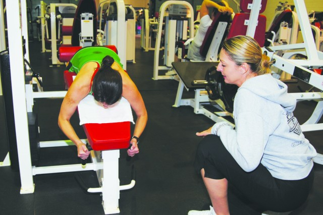 Fort Polk, La. -- Personal fitness trainer Susie Brown (right) works with Julie Benson at Cantrell Gym Jan. 26. Fort Polk's Directorate of Family Morale, Welfare and Recreation has seven personal trainers on staff for use by post personnel.