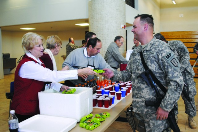 Apple Pie Brigade greets troops with smiles, pies