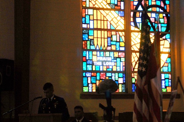 FORT HOOD, Texas.- Spc. Keevon Shipley, with B Company, 3rd Battalion, 8th Cavalry Regiment, 3rd Brigade Combat Team, 1st Cavalry Division presents a speech at a memorial service for his friend, Spc. Ian Borelli, Jan. 26 on Fort Hood.
