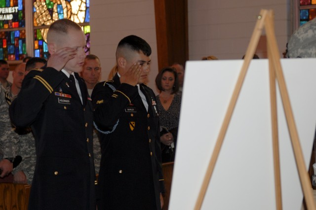 FORT HOOD, Texas - Chaplain (Capt.) Robert Holsinger (left), the chaplain for 3rd Battalion, 8th Cavalry Regiment, 3rd Brigade Combat Team, 1st Cavalry Division, and Spc. Keevon Shipley render honors to Spc. Ian Borelli at his memorial service on Fort Hood Jan. 26.