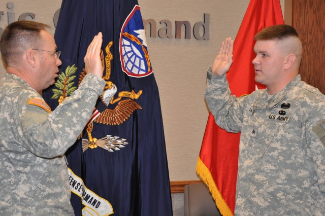Soldier re-enlists for another four years