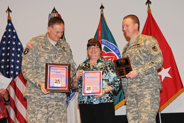 Branda Bell (center), USASAC CFC financial chairperson; and Col. Bob Pastorelli (right), USASAC chief of staff; accept awards from Maj. Gen. James E. Rogers, AMCOM Commanding General and Honorary Chairman for the Tennessee Valley CFC; on behalf of USASAC for the command\'s successful Combined Federal Campaign.