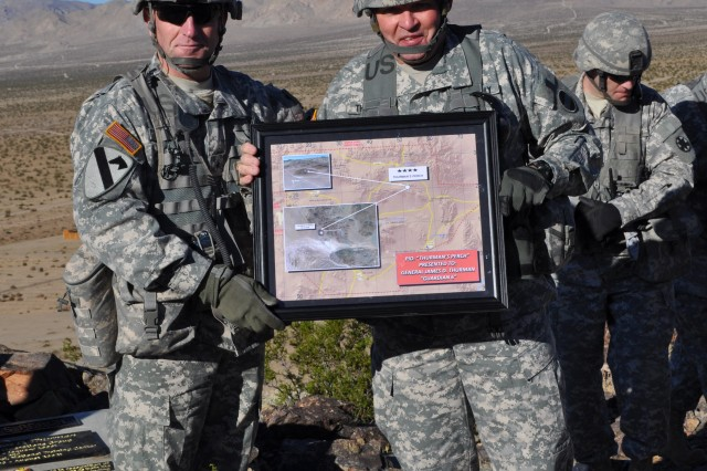 """When FORSCOM commander Gen. James D. Thurman was honored with a Place in Desert, Fort Irwin and National Training Center commanding general Brig. Gen. Robert """"Abe"""" Abrams presented him with a plaque marking the occasion on Nov. 12, 2010."""