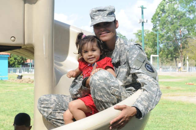 Specialist Nitza Torres spends quality time with her daughter Nayha during the 475th Eng. Company farewell ceremony.