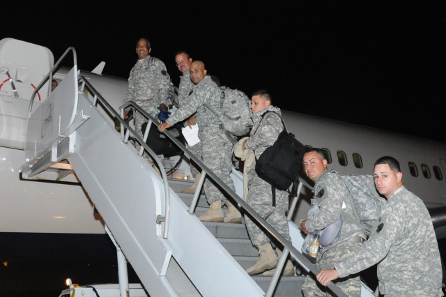 475th Engineer Company Soldiers board as part of their mobilization.
