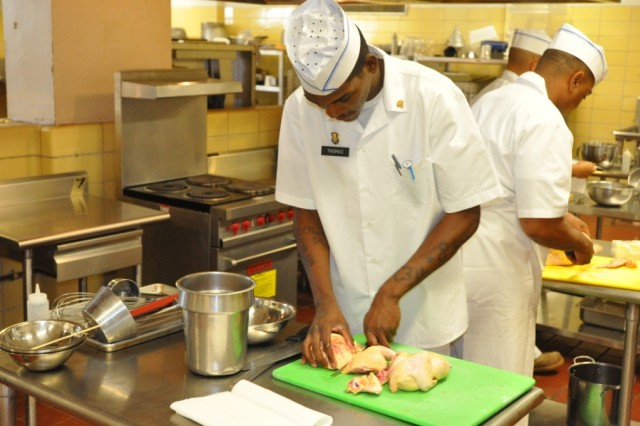 Specialist Detavius Thomas, a food service specialist, assigned to E Troop, 2nd Squadron, 6th Cavalry Regiment, 25th Combat Aviation Brigade, prepares his main dish during the tryouts for the 36th Annual U.S. Army Culinary Arts Competition at B Quad Dining Facility on Schofield Barracks, Hawaii, Jan. 20.  (Photo by: Sgt. Daniel Schroeder  25th Combat Aviation Brigade Public Affairs)