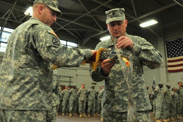 Lieutenant Col. Corey New, (left) and Command Sgt. Maj. Bruce Acker, (right) 53rd Transportation Battalion command team, case the battalion colors during a deployment ceremony Jan. 28 at Fort Eustis' Anderson Field House. The battalion will deploy approximately 50 Soldiers to Iraq next month in support of Operation New Dawn. The unit will provide command and control of movement control teams in order to ensure the effective movement of cargo, personnel and units. (U.S. Army photo by Sgt. Edwin J. Rodriguez)