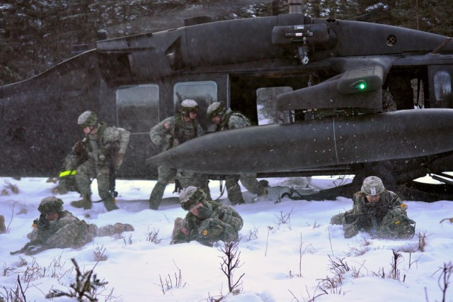 The Alaska National Guard places the rotary wings in high gear as Soldiers dismount from the Black Hawk Jan. 27, at Landing Zone 17.