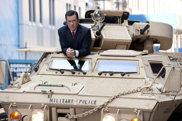 "Stephen Colbert arrives in a Military Police Armored Security Vehicle during the ""Been There: Won That: The Returnification of the American-Do Troopscapeon"" special of The Colbert Report, Sept. 8, 2010, in New York."