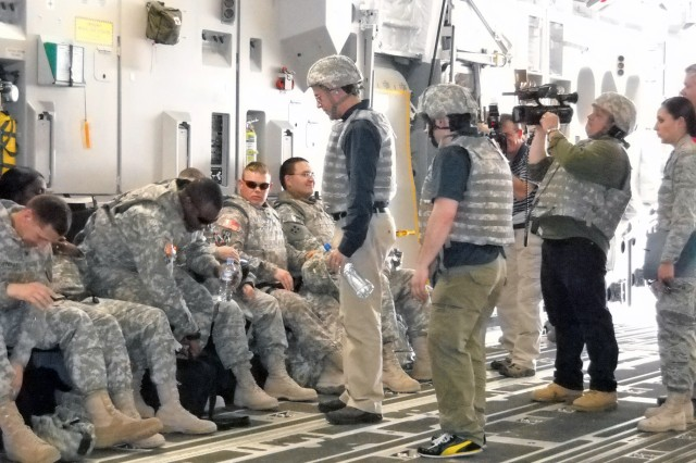 "Actor/comedian Stephen Colbert of Comedy Central's ""The Colbert Report"" visits with U.S. military personnel on a C17 Globemaster bound for Iraq."