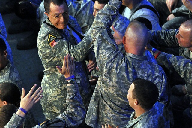 "Stephen Colbert, of Comedy Central's ""The Colbert Report,"" high-fives members of the audience during his performance at Al Faw Palace in Baghdad, June 7, 2009."