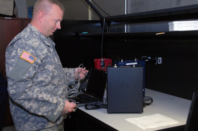 Sgt. 1st Class Charles Moening adjusts radio equipment at the White House Communications Agency headquarters.