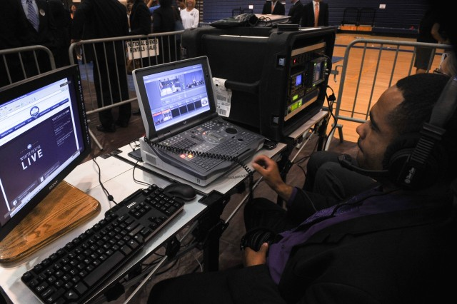 A White House Communications Agency employee prepares a video presentation for an event.