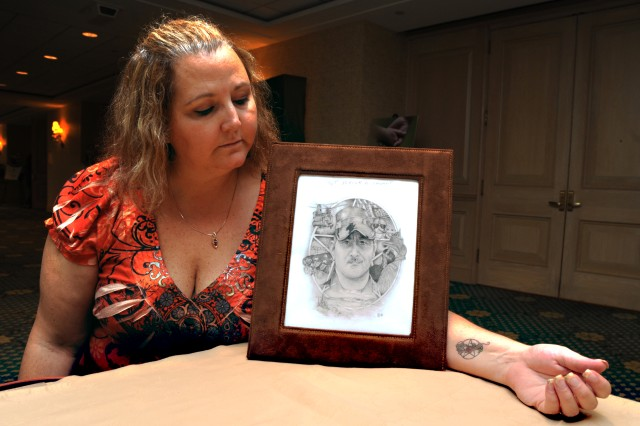 Roberta Stewart lost her husband, Sgt. Patrick D. Stewart, to an insurgent's rocket-propelled grenade. She holds an artist's rendering of Patrick.