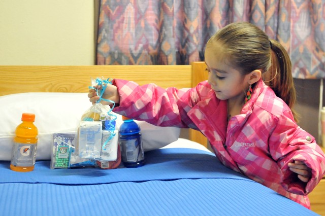 In addition to freshly made beds, returning III Corps troops can enjoy packages of candy, soft drinks and toiletries thanks to Myla Velasquez, 5, daughter of Melissa Velasquez, III Corps battalion Family Readiness Group leader.