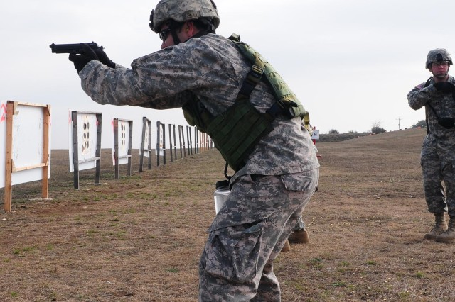 CAMP BULLIS, Texas - Sgt. 1st Class Antonio Turberville, operations noncommissioned officer, Headquarters Support Company, Army North, fires an M-9 Berretta Pistol during advanced marksmanship training Jan. 20 at the Camp Bullis Military Training Reservation in San Antonio.