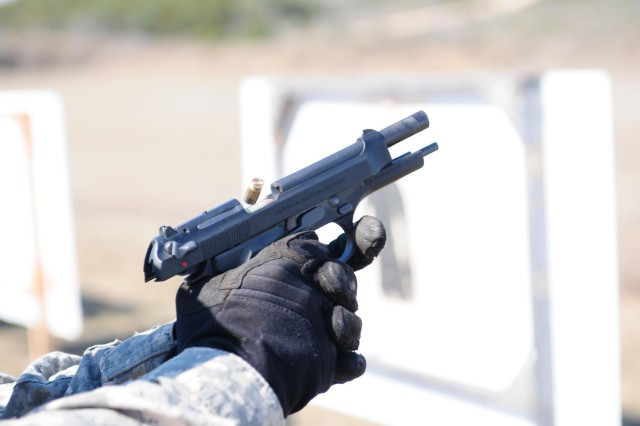 CAMP BULLIS, Texas - Sgt. 1st Class Antonio Turberville, operations noncommissioned officer, Headquarters Support Company, Army North, fires an M-9 Berretta Pistol Jan. 20 during advanced marksmanship training at the Camp Bullis Military Training Reservation in San Antonio.