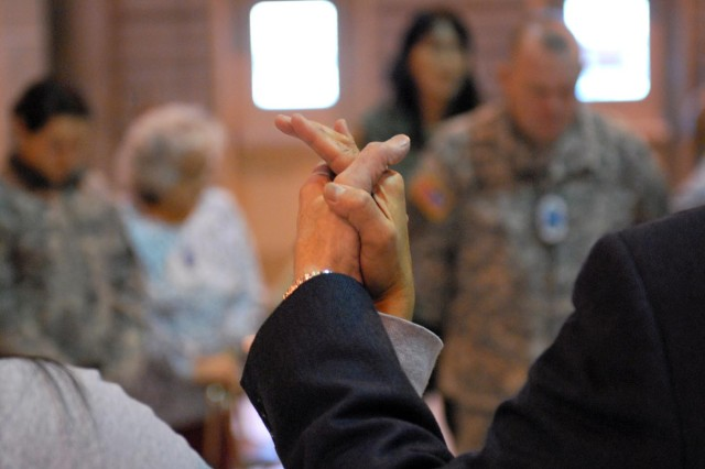 FORT WAINWRIGHT, Alaska - Alaska Natives join hands in prayer with 16th CAB Soldiers during the potlatch, adding to the traditional Athabascan feast of food, song, dance and speeches.