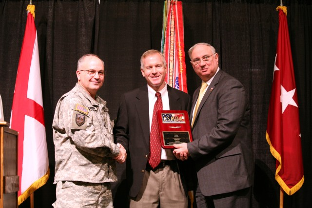 Lt. Gen. Richard P. Formica, commanding general, U.S. Army Space and Missile Defense Command/Army Forces Strategic Command, left, and Robert C. Pollard Jr., 2010 Air, Space, and Missile Defense Association president, right, congratulate USASMDC/ARSTRAT employee Kevin Nash for receiving a Technical Achievement Award from ASMDA during the group's annual luncheon Jan. 31 at the Von Braun Center in Huntsville. Other command employees receiving awards were: Edwin Barber, Technical Achievement Award; Robert O'Connell, Technical Achievement Award; Paul Page, Service Excellence Award; Cheryl Holbrook, Service Excellence Award; and Steve Cayson, Sevice Excellence Award.