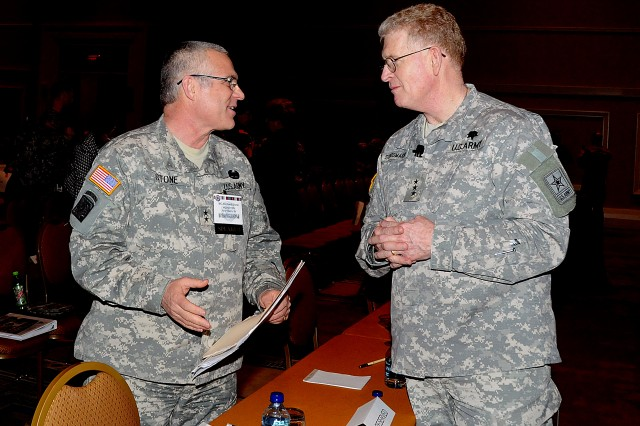 Gen. Richard A. Stone, U.S. ArmyAca,!a,,cs deputy surgeon general for Mobilization, Readiness, and Reserve Affairs, discusses Soldier Medical Readiness points with Army Surgeon General Lt. Gen. Eric B. Schoomaker.