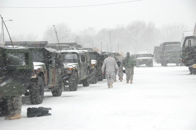 Soldiers with the Illinois National GuardAca,!a,,cs 3637th Maintenance Company load their Humvees before moving out to provide roadside assistance to stranded motorists on Illinois interstate highways, Feb. 1, 2011.