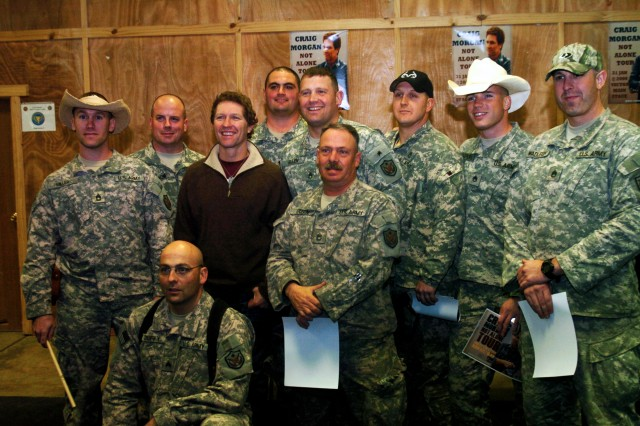 Country musician Craig Morgan meets with Staff Sgt. Victor Sorrento and other members of the U.S. Forces - Iraq 'Roughriders' Covoy Operations team following a concert at Camp Victory, Iraq.