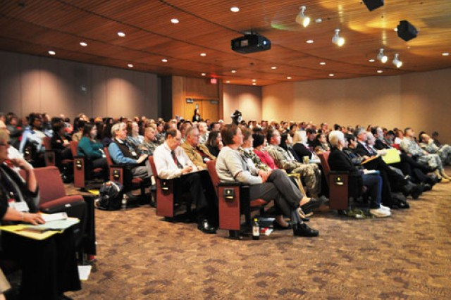 More than 350 people listen as experts in education and standardization of pain management speak at Madigan Healthcare System Jan. 31. The conference was so well attended that two overflow rooms were filled in addition to the Letterman Auditorium during the morning's keynote speeches.