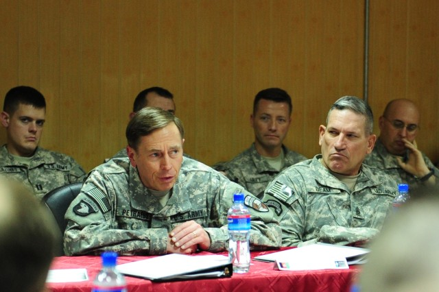 Gen. David  H. Petraeus, commanding general of International Security Assistance Force and U.S. Forces Afghanistan, addresses the Regional Support Commanders Conference attendees Feb. 2, flanked by Command Sgt. Maj. Ralph R. Beam,  NATO Training Mission-Afghanistan/Combined Security Transition Command - Afghanistan at Camp Eggers, Kabul, Afghanistan.